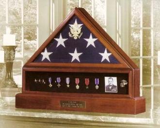 The Presidential Pedestal Urn Flag & Medal Display Case is a beautiful urn in a Walnut or Cherry finish and is crafted in the USA.
